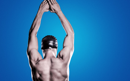 vignette: Swimmer preparing to dive against purple vignette