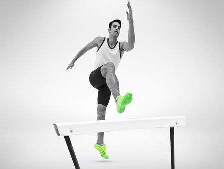 athleticism: Male athlete running on isolated white background