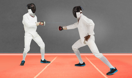 playing field: Man wearing fencing suit practicing with sword against digitally generated image of playing field
