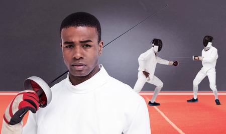 swordsman: Portrait of swordsman holding sword against digitally generated image of playing field