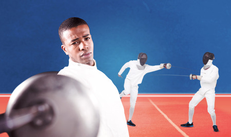 fencing sword: Swordsman practicing with fencing sword against digitally generated image of tracks