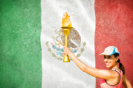 raise the white flag: Happy woman raising a cup  against digitally generated mexican national flag Stock Photo