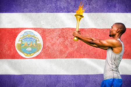 profile view: Profile view of sportsman holding a cup  against costa rica national flag Stock Photo