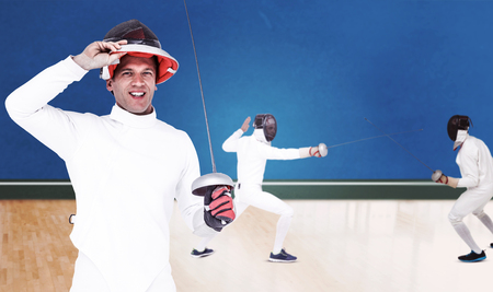 digitally generated image: Man wearing fencing suit practicing with sword against digitally generated image of bicolored background