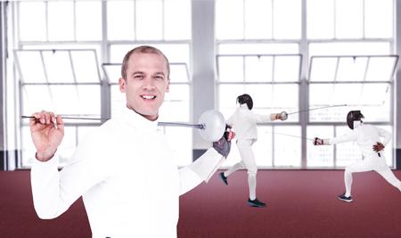 fencing sword: Swordsman holding fencing sword against gym