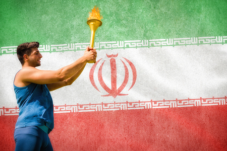 low prizes: Low angle view of sportsman holding a cup  against digitally generated iran national flag