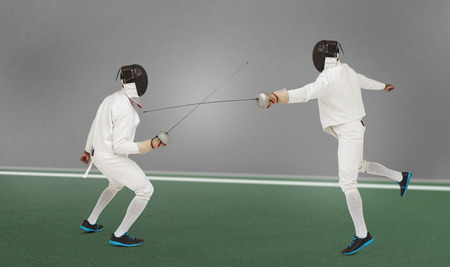 bicolored: Man wearing fencing suit practicing with sword against digitally generated image of bicolored background