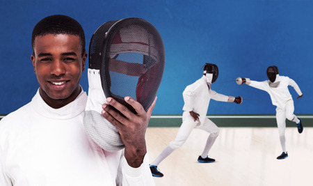 bicolored: Swordsman holding fencing mask against digitally generated image of bicolored background