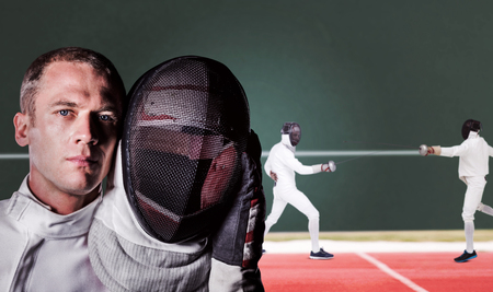 playing field: Close-up of swordsman holding fencing mask against digitally generated image of playing field