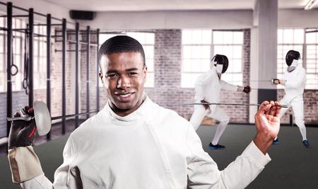 swordsman: Portrait of swordsman standing with sword against gym