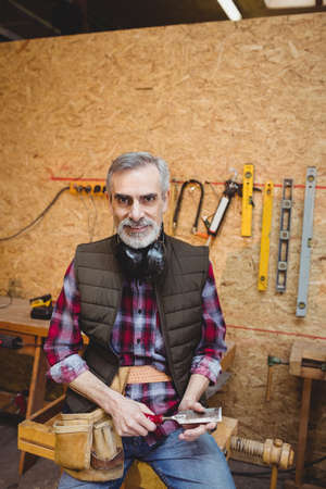 anti noise: Portrait of a carpenter in carpentry