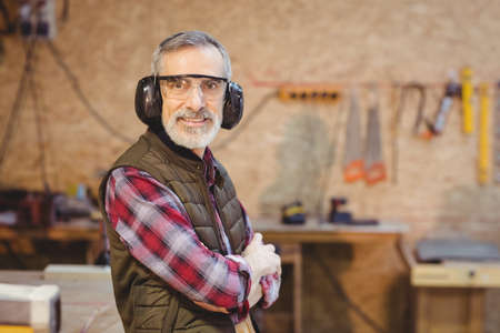 anti noise: Portrait of a carpenter in the carpentry LANG_EVOIMAGES