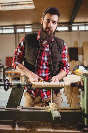 sculpting: Carpenter sculpting a wood piece in carpentry
