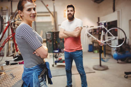 repairer: Portrait of bicycle repairer colleagues in a workshop LANG_EVOIMAGES