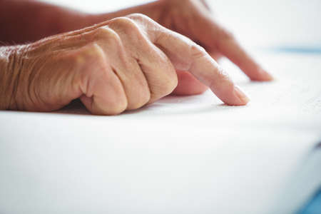 blindness: Close-up of two pointing finger on a book