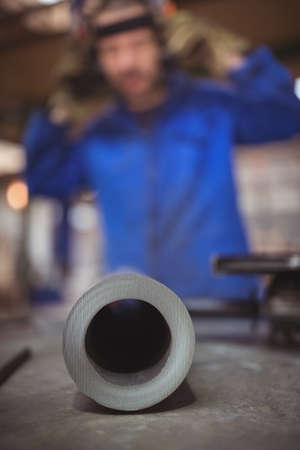 focus on the foreground: Focus on foreground of a pipe in a workshop