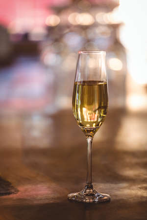 glass half full: Close-up of champagne flutein restaurant