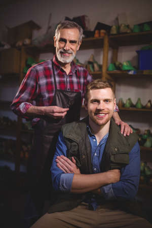cobbler: Portrait of cobbler men smiling in workshop LANG_EVOIMAGES