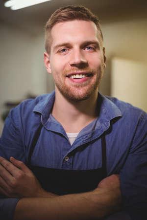 cobbler: Portrait of cobbler smiling in workshop LANG_EVOIMAGES