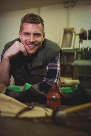 cobbler: Portrait of a smiling cobbler in his workshop LANG_EVOIMAGES
