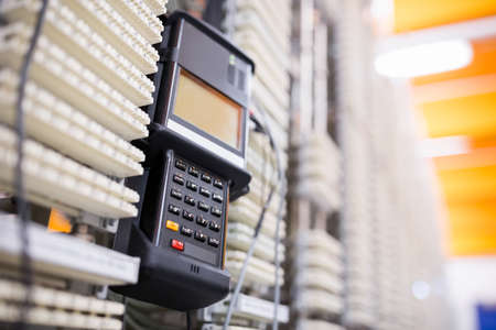 analyzer: Close-Up of digital cable analyzer on rack mounted server in server room