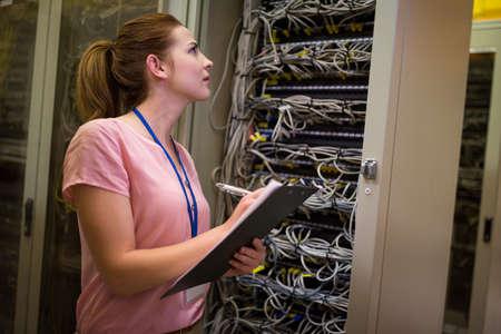 check room: Technician preparing check list in in server room