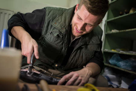 cobbler: Cobbler doing his work alone in a workshop