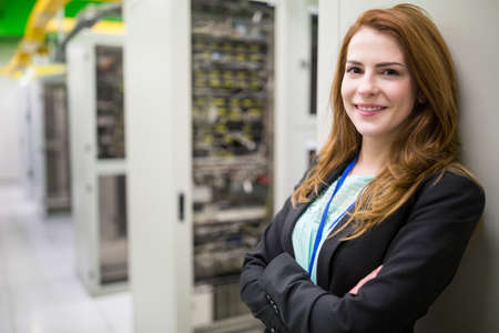network server: Portrait of technician with arms crossed in a server room