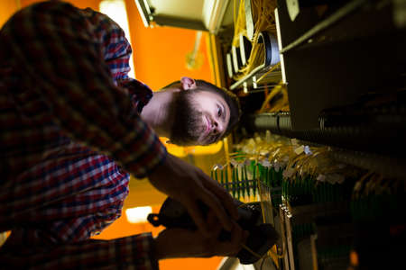 analyzer: Technician using digital cable analyzer in server room LANG_EVOIMAGES