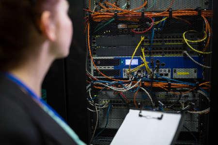 check room: Technician preparing check list in server room