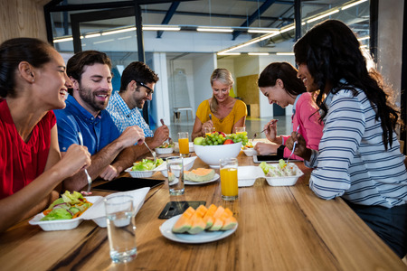 Casual business team eating together in the office Stock Photo