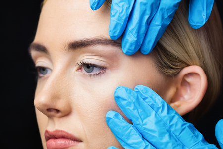 examination room: Woman has an examination of her skin before Botulinum toxin injection in a examination room Stock Photo