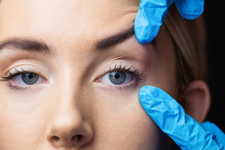 examination room: Woman has an examination of her skin before botox injection in a examination room Stock Photo