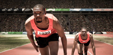 starting block: Athlete man in the starting block against athletic field in a stadium