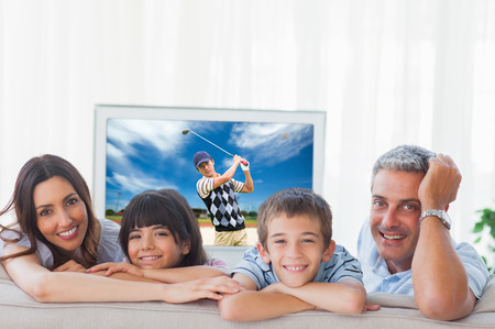 family  room: Composite image of family in sitting room smiling at camera