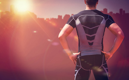Rear view of athlete man posing against cityscape on sunlight Stock Photo