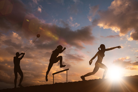 discus: Profile view of sportswoman practising discus throw  against clouds Stock Photo
