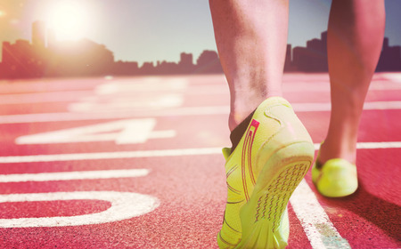 composite image: Close up of athletic feet against a white background against composite image of race track Stock Photo