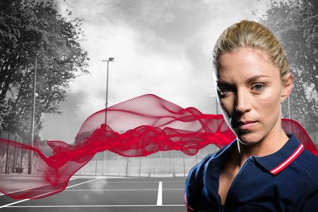 composite image: Portrait of female tennis player against composite image of tennis field on a sunny day Stock Photo