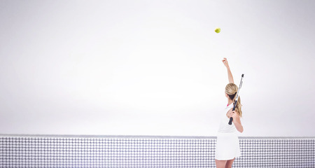 racquet: Athlete holding a tennis racquet ready to serve  against grey background