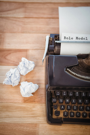 role  model: Role model message  against typewriter with crumpled paper on table in office