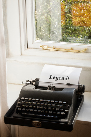 legend: Legend! message  against typewriter on a table Stock Photo