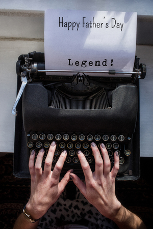 legend: Legend! message  against womans hand typing on typewriter