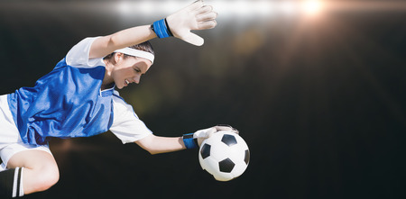 stopping: Woman goalkeeper stopping a goal  against spotlight