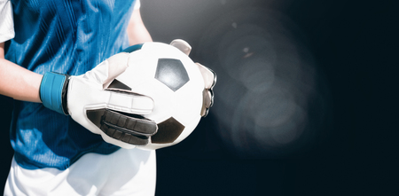 animated women: Close up of a football held by sportswoman  against view of lighting