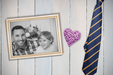 composite image: Composite image of a wooden heart  against wooden planks Stock Photo