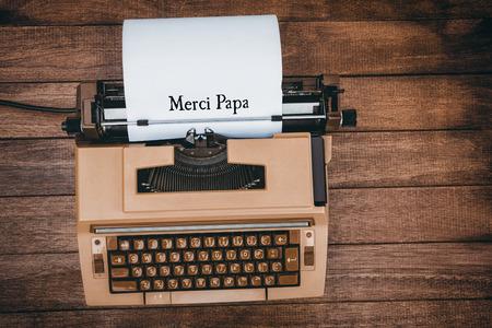 merci: Merci papa written on paper with typewriter
