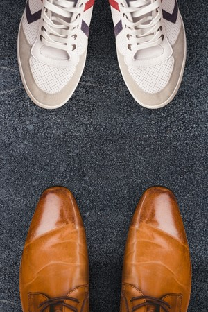 dress shoes: Focus of brown dress shoes  against black road Stock Photo