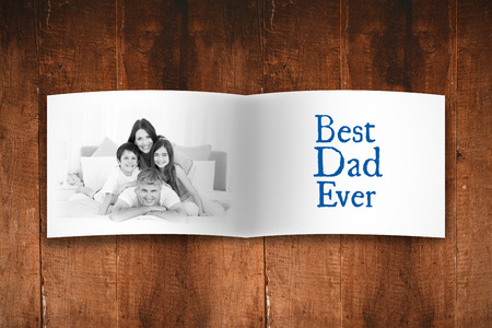 endearment: Attractive smiling father with family against overhead of wooden planks