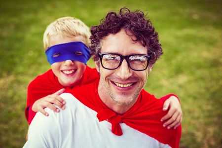 one parent: Father and son dressed as hero in the garden
